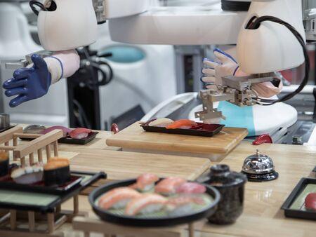 Robotic arm preparing japanese food a dish of sushi Stok Fotoğraf - 128186392