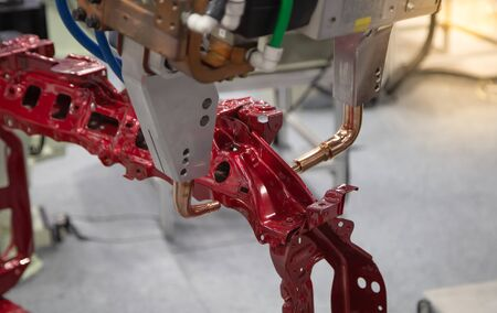 Automated robotic arm spot welding in automotive industry