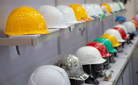Variety color of safety helmets on shelf of warehouse store