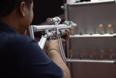 Man shooting aluminium light weight frame rubber band gun