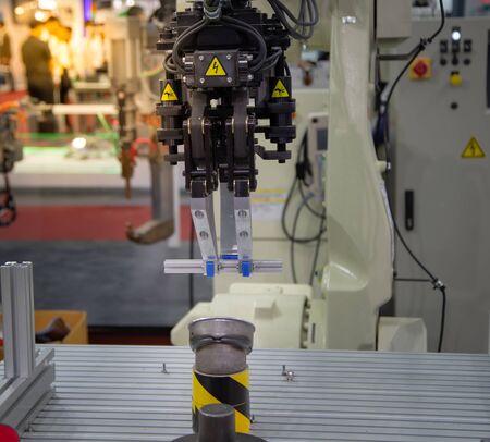 Robotic arm lifting aluminium light weight frame part in manufacturing factory Stok Fotoğraf - 128186687
