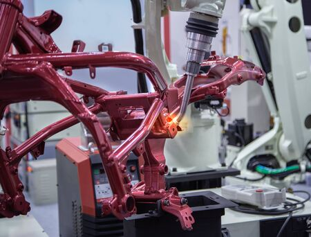 Automated robotic arm welding in automotive industry
