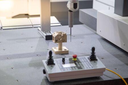 Measuring automotive part on the Coordinate Measuring Machine (CMM)