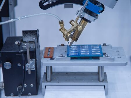 Automated robot soldering electronic PCB circuit board Фото со стока