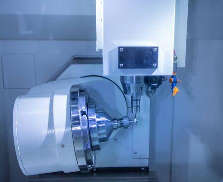 CNC milling machine cutting small gear part Stok Fotoğraf - 128186939