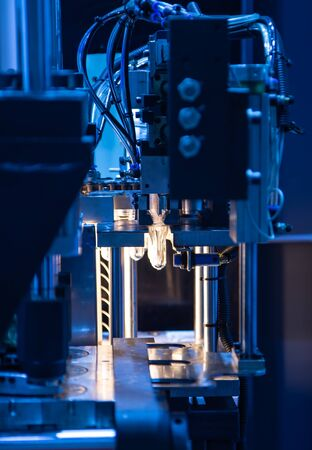 Raw material of PET plastic bottle on blowing machine pre-heat process Stok Fotoğraf - 128187277