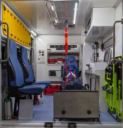 Interior of an ambulance with bed and patient care equipment