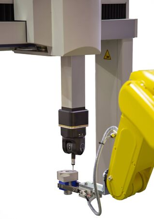 Robotic arm loading workpiece to CNC CMM Coordinate Measuring Robotic isolated on white background Stok Fotoğraf
