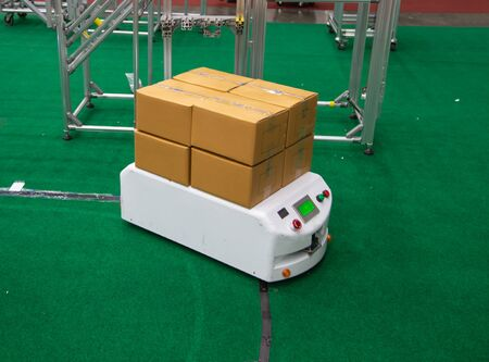 Robot carry cardboard in modern warehouse logistic