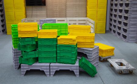 Stack of colorful empty plastic crate container
