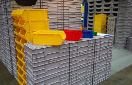 Stack of industrial open plastic bin rack