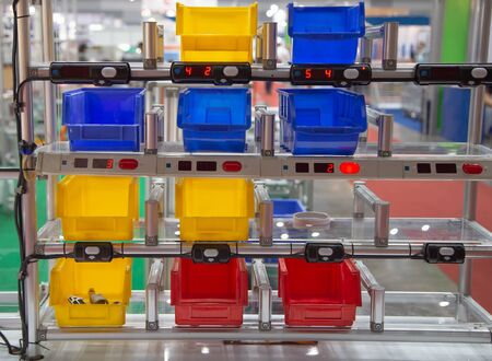 Industrial open plastic bin rack for component parts in warehouse