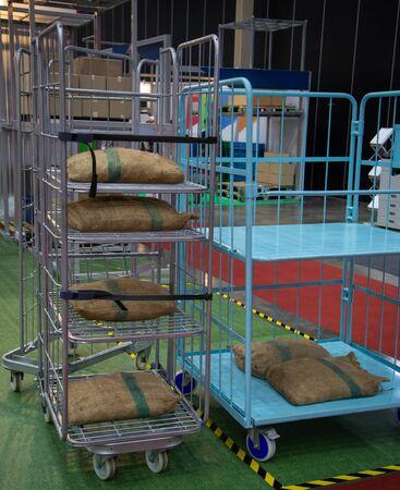Burlap sack on folding roll pallet trolley logistic