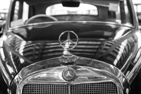 Nakhon Pathom, Thailand - August 3, 2019: Mercedes Benz 300B badge in black and white color exhibit at vintage car collector garage in Nakhon Pathom province