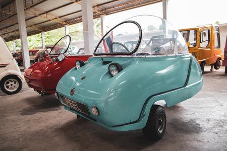 Nakhon Pathom, Thailand - August 3, 2019: Vintage microcar Peel Trident exhibit at vintage car collector garage in Nakhon Pathom province Redactioneel