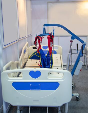 Hospital bed with hydraulic lifting device in modern hospital