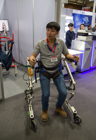 Nonthaburi, Thailand - July 11, 2019: Man demonstrate patient walking aid in Medical Device Asean 2019