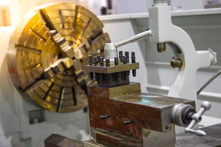 Close up of lathe machine in industrial workshop