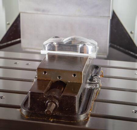 CNC milling machine. Cutting workpiece sport car, industrial machining Stockfoto