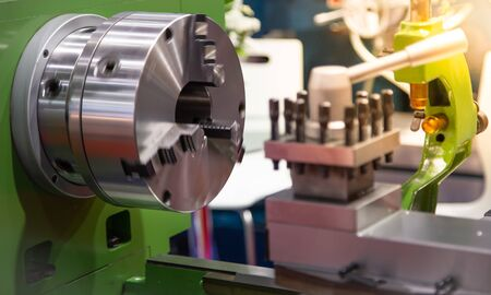 Close up of running lathe machine in industrial workshop Stockfoto