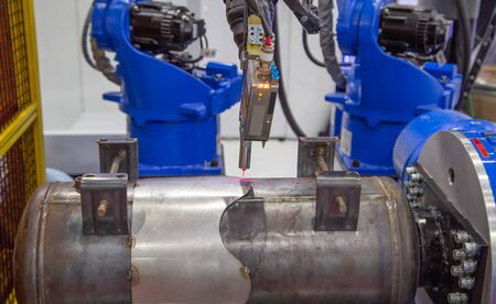 Seam tracking laser system for automated robotic welding