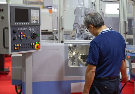 Worker control compact CNC lathe with robotic loading workpiece