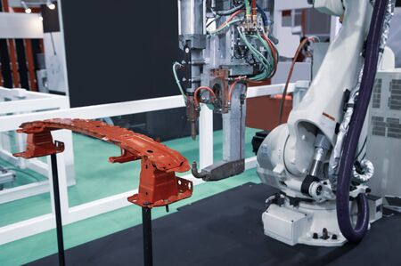 Robot arm demonstrate spot welding car parts