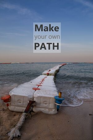 Motivational quote make your own path on sea buoys line on the beach