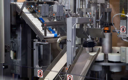 Cosmetic aluminum tube filling machine in production line. Pharmaceutical industry