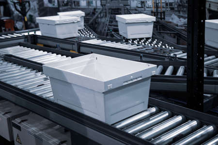 Automatic sorting system of plastic tray in industry warehouse
