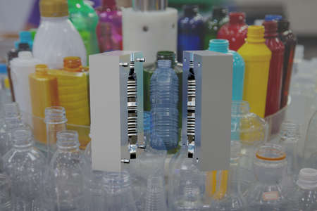 Mould of PET plastic bottles drinking water container on background of variety bottle products