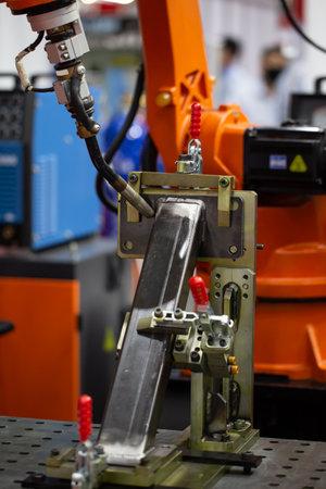 Industrial robot arm welding structural beam in construction heavy industry. Stock fotó