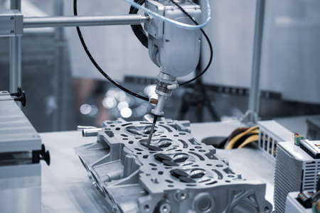 Industrial robot arm demonstrate assembly engine part