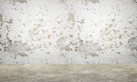 Fragment chipped white wall and concrete floor. Old grungy texture background Stock fotó
