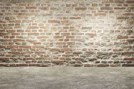 Old brick wall and concrete floor. Empty interior design. Old grungy texture background