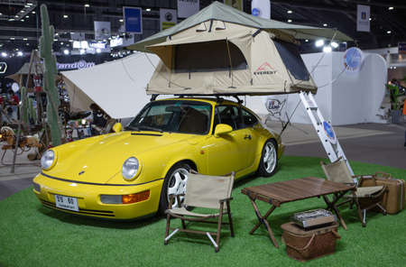 Bangkok, Thailand - April 4, 2021: Porsche 911 equipped with roof top tent exhibited in BANGKOK INTERNATIONAL MOTOR SHOW 2021
