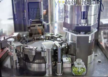 Capsule filling and packing machine in pharmaceutical manufacturing factory.