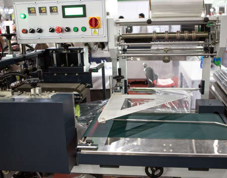 Package shrink film wraping machine in industrial warehouse