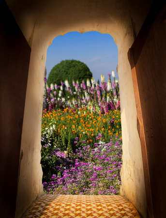 View from door of castle. Scenery view of beautiful flower in the garden. Travel concept 版權商用圖片