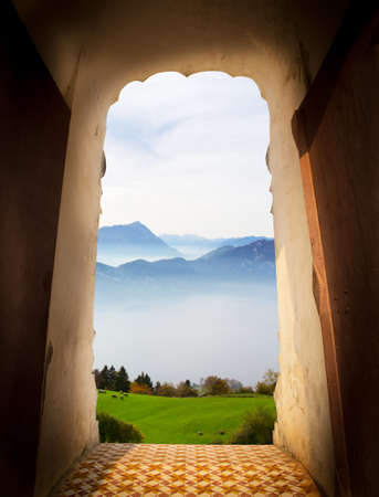 View from door of castle. Scenery view of mountain with fog. Travel concept