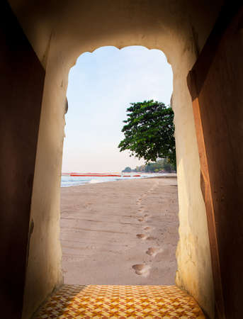 View from door of castle. Scenery view of beach. Footprint in sand beach along the sea shore. Travel concept