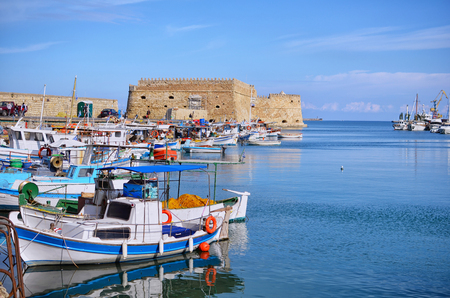 Heraklion, Crete - Greece. Traditional fishing boats in front of the fortress Koules (castello a mare) at the old port in Heraklion