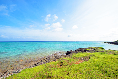 multiplying: Blue sea and green cliff, Okinawa, Japan Stock Photo