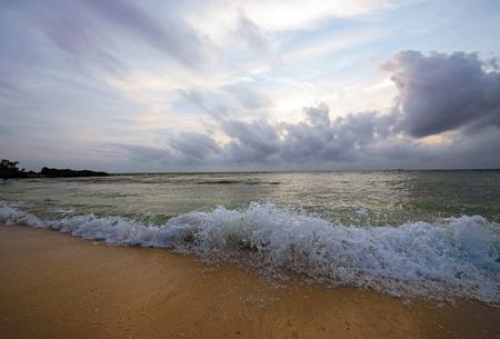 waterside: Clouds and waves splash, Okinawa, Japan Stock Photo