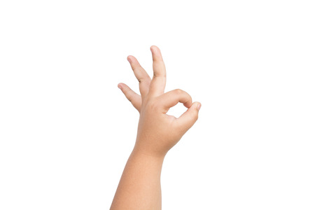 all ok: Children hand is making OK gesture meaning success or everything is all right isolated on white background
