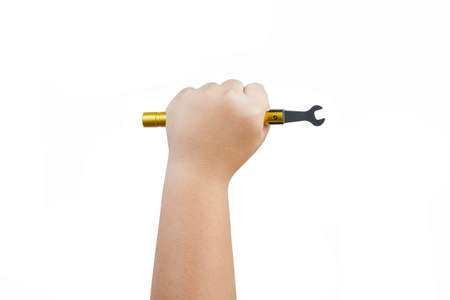 torque: Torque Wrench with children hand isolated on white background