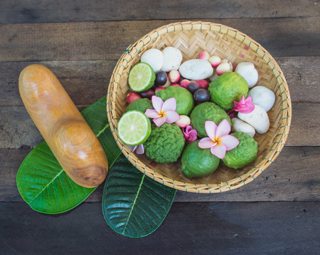 Spa thai massage with Kaffir Lime on wooden background