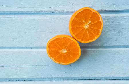 fruits juice: Slice of fresh orange  on pastel background