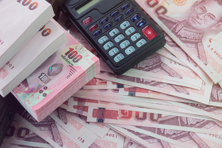 sell shares: Money with calculator - Money bonus for business Stock Photo