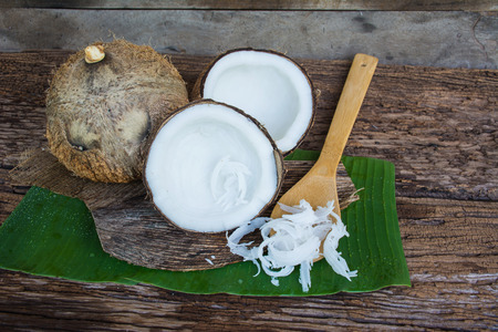 copra: coconut and copra with spoon on  wooden background